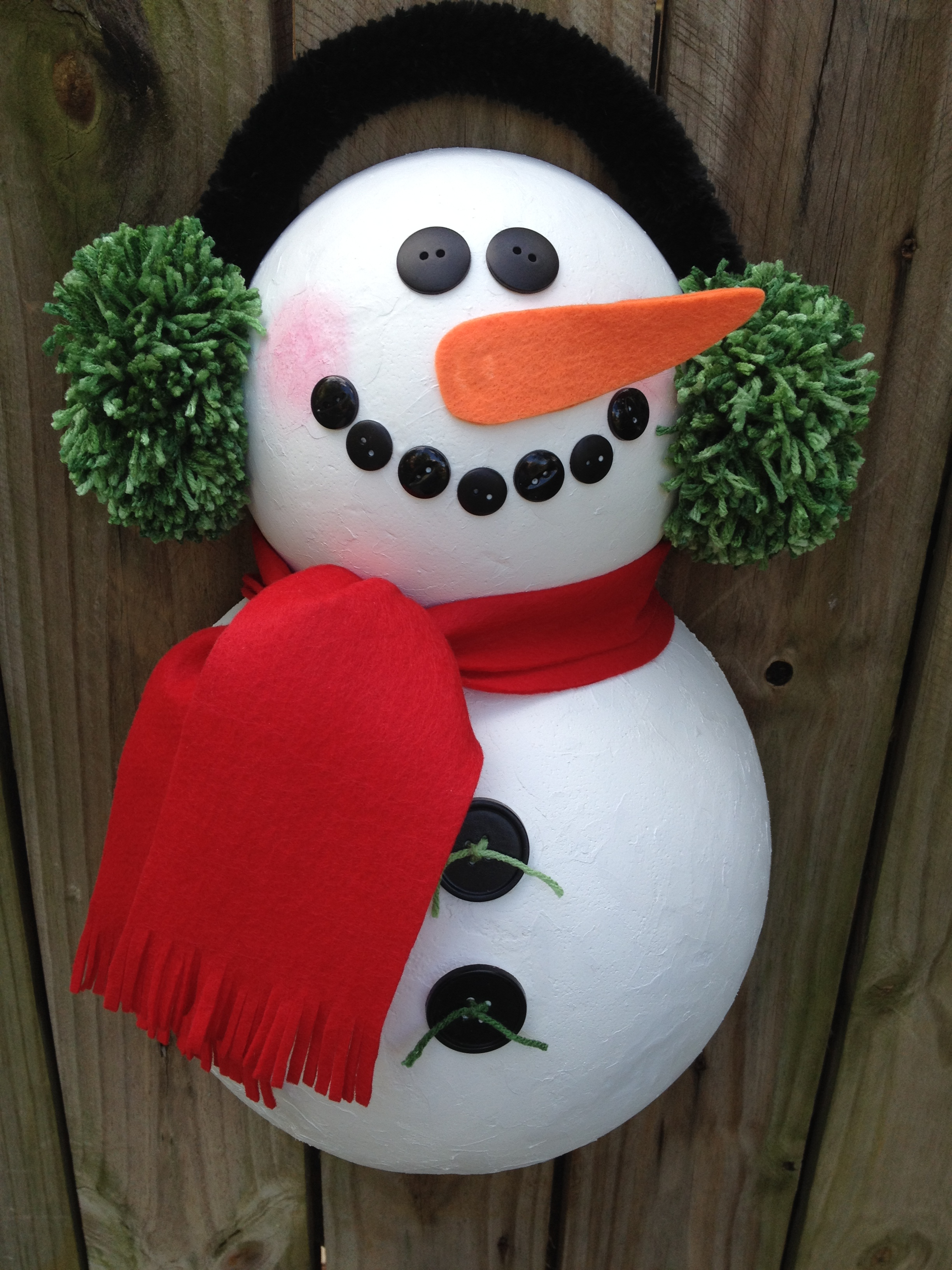 Snowman door hanger a festive and cheery change of pace from a